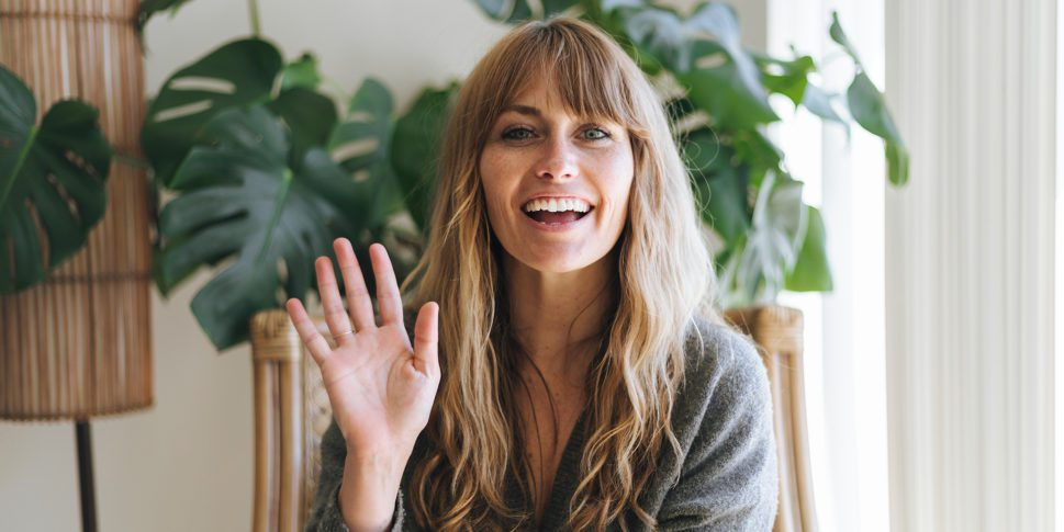 woman-smiling-and-waving